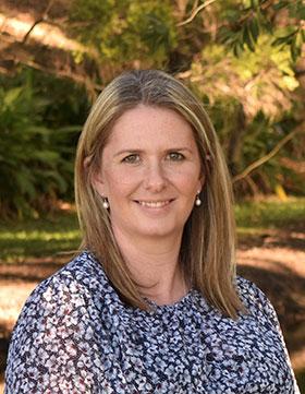 Dr Laura Baxter, blonde woman wearing floral shirt